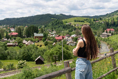 Hiker girl on the mountain top, �oncept of freedom, victory, active lifestyle Standard-Bild