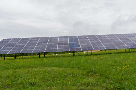 Photovoltaic solar power panel on sky background, green clean alternative energy concept