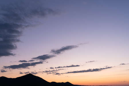 Sunset mountain peaks sky panorama. Mountain peaks sunset view. Sunset mountain peaks silhouette Standard-Bild