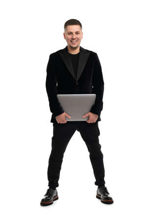 Portrait of young businessman with laptop in hands isolated on white