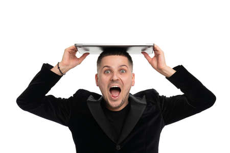 Excited businessman posing isolated over white wall background holding laptop computer Standard-Bild
