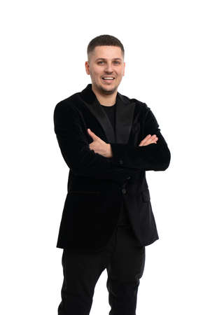 Portrait of happy businessman with arms crossed isolated over white
