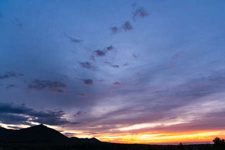 Panorama colorful magnificent sunset in countryside above hills and fields 版權商用圖片