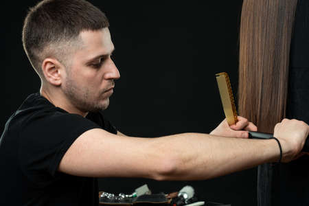 Young professional hairdresser with long brunette hair model