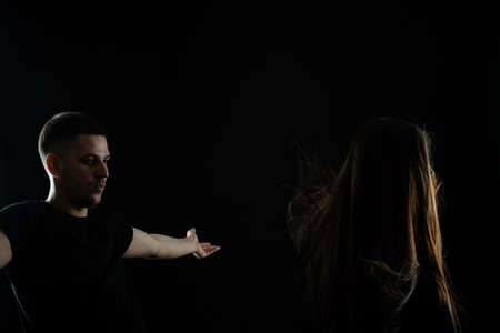 Creating new hair look. Young barber, hairdresser stands with raised hands near his client girl model