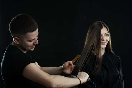 Hairdressing services. Hair styling process in a beauty salon