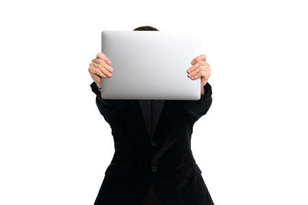 Young man hide his face behinde laptop, isolated on white Standard-Bild - 152318614