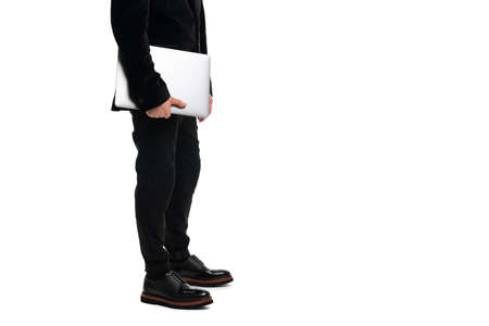 Cropped view of businessman holding laptop isolated on white background 版權商用圖片