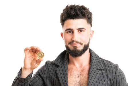 Young bearded stylish businessman holding bitcoin isolated on white 版權商用圖片