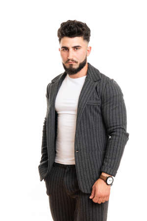 Masculine glamorous groomed attractive elegant serious financier looking at camera isolated on white background