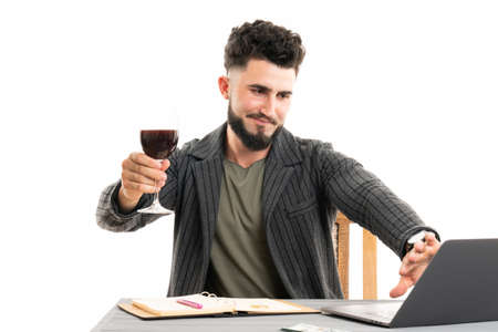 Businessman holding the glass of red wine and gesturing stop sign by his palm. Represents outcry alcoholic dependency Standard-Bild - 152533212