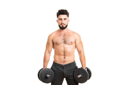 Muscular man with dumbbells isolated on the white background. Strong male naked torso abs 版權商用圖片