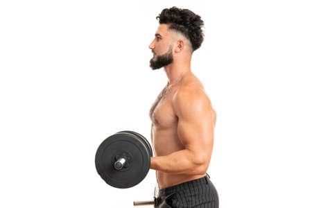 Muscular man working out doing exercises with dumbbells at biceps, strong male naked torso abs