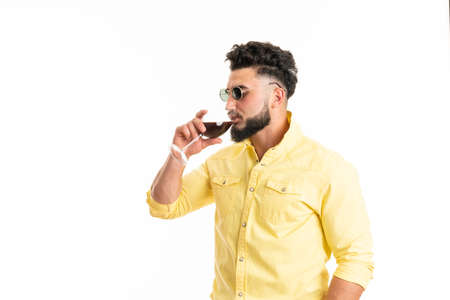 Sommelier, degustator with glass of red wine, winery, male winemaker. Beard man, bearded, sommelier tasting red wine. Man with a glass of wine in his hands