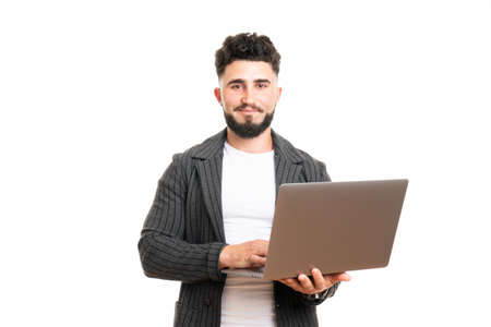 Pleasant positive business man using laptop, isolated over white background 版權商用圖片