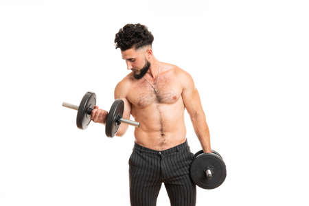 Muscular young bearded gentleman pumping up biceps isolated on white