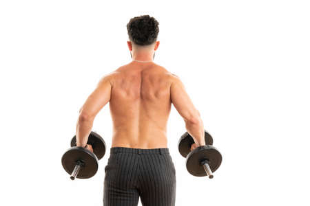 Back of shirtless muscular young man holding dumbbells