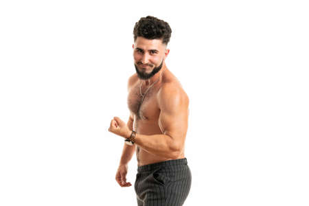 Sport, gym and strength concept. Sexy good-looking muscular young man in perfect shape, standing with naked torso, raising hand proudly showing strong big muscles