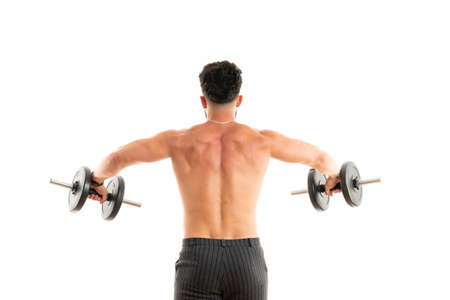 Athletic man showing muscular body with dumbbells, rear view, full length, isolated over white background