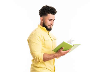 Photo of funny handsome guy holding green book favorite business motivation positive emotions 版權商用圖片