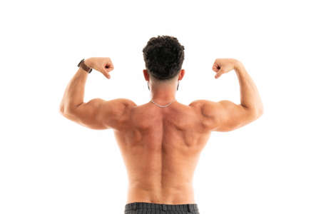 Strong Athletic Man - Fitness Model showing his perfect back isolated on white 版權商用圖片