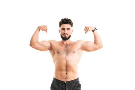 Muscular man bodybuilder isolated on a white background. Male shows his muscles