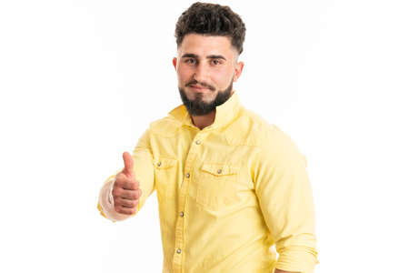 Young handsome man with beard over isolated white background with thumbs up 版權商用圖片