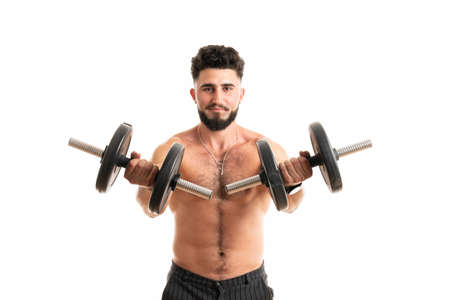 Handsome power man fitness-model with six packs is training with dumbbells, isolated on white background with copyspace