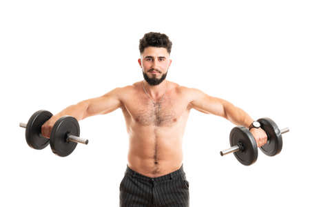 Torso shot of a young man with bare chest lifting dumbbells. Fit young man exercising with dumbbells on white background 版權商用圖片