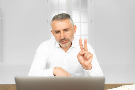 Inspiring productivity with a wealth of technology, adult man talking at video call