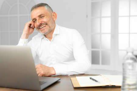 Successful businessman working on laptop in modern luxury office desk. Young entrepreneur satisfied with work result analyzing financial indicators on computer Standard-Bild - 153361265