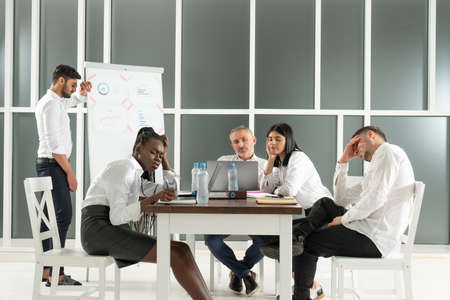 Business, teamwork, people and crisis concept - business team sitting sad and solving problem in office Standard-Bild - 153234078
