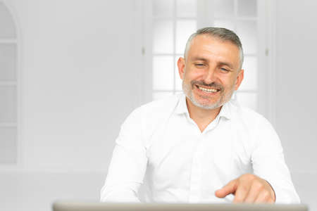 Smiling european employee have video call on laptop