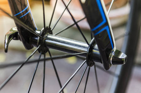 The front wheel of the bike and the front wheel hub are ready to race.