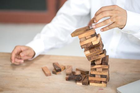 Tower block, falling block, risk management, business concept, focus background, focus