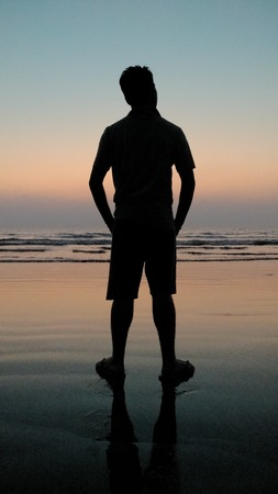 Boy silhouette on beach 写真素材