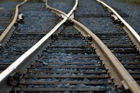 Rail road tracks crossing each other Stock Photo