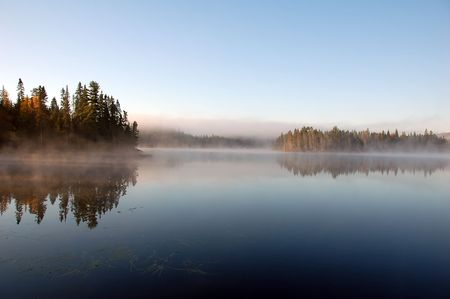 A beautiful autumns landscape in the morning with fog and mist Reklamní fotografie