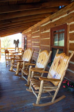log deck: 3 rocking-chair on the front porch of a traditional old farm