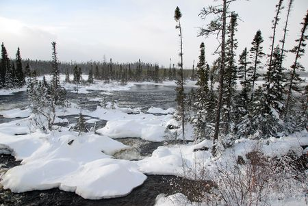 A northern river surronded by snow on a cold day Stock Photo - 2370904