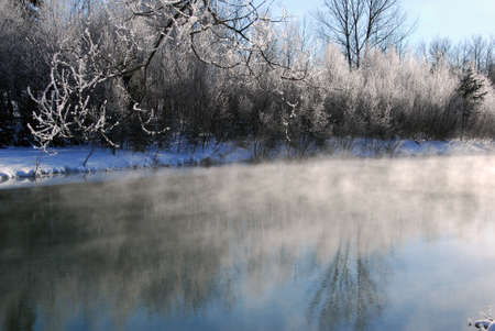 A winter landscape showing a foggy river on a cold day Stock Photo - 2396201