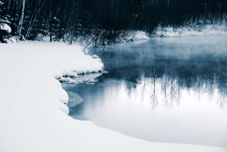 A winter landscape showing a foggy river in blue tones Stock Photo - 2396200