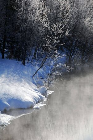 A winter landscape showing a foggy river on a cold day Stock Photo - 2409403
