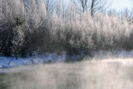 A winter landscape showing a foggy river on a cold day Stock Photo - 2409412