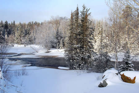 A landscape showing a frozen river in Winter Stock Photo - 2409413