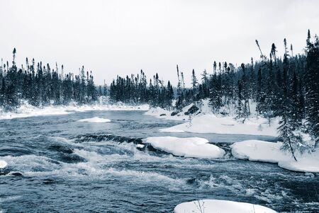 A winter landscape showing a foggy river in blue tones Stock Photo - 2409409