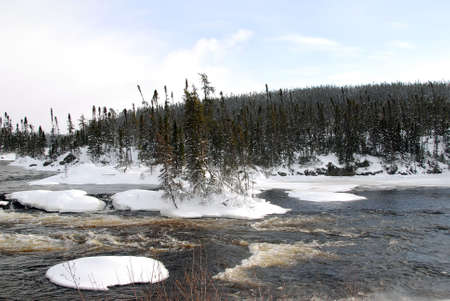 A northern river surrounded by snow on a cold day Stock Photo - 2451491