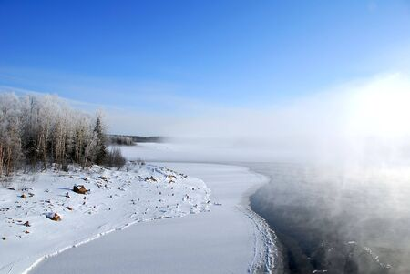 Winter landscape showing a frozen river on a very cold day Stock Photo - 2527665