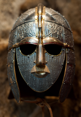 An ornately decorated Anglo-Saxon helmet in the museum at Sutton Hoo, Suffolk