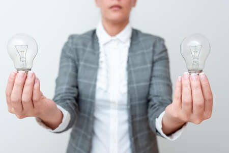 Lady Carrying Two Lightbulbs In Hands With Formal Outfit Presenting Another Ideas For Project, Business Woman Holding 2 Lamps Showing Late Technologies, Lighbulbexhibiting Fresh Openion